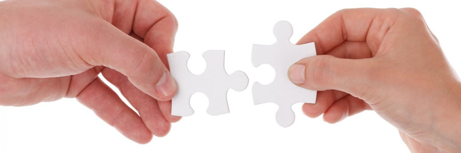 hands joining puzzle pieces together